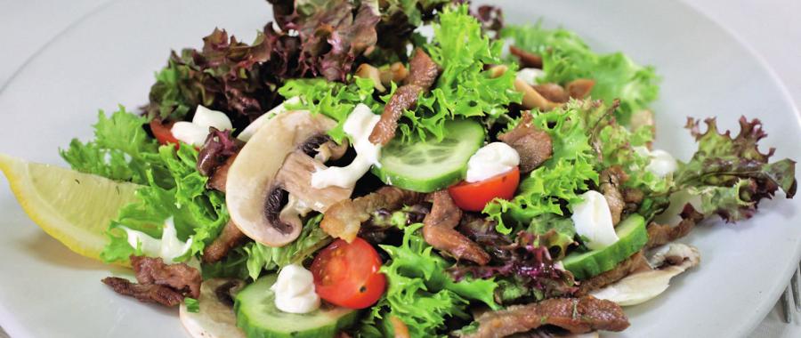 Салат з печерицями та свининою